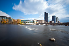 The Longest River in Michigan (Rudy Malmquist) Tags: plaza city bridge autumn water clouds river jw hotel rocks long exposure downtown cityscape place angle michigan wide grand rapids nd streaks scape current density amway mariott neutral devos