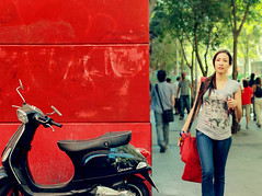 { Real street diptych } (Ges Rules ) Tags: madrid street city red people urban woman girl rouge calle mujer spain rojo diptych vespa scooter motorbike moto