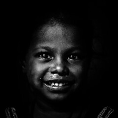 A smile is a curve that sets everything straight (ayashok photography) Tags: portrait bw india girl smile blackwhite kid nikon madras poor streetphotography chennai bnw nikkor50mm parrys ayashok nikond300 aya9592v2