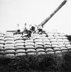 Pile of grain sacks [with children sitting on it]