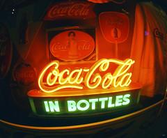 Vintage - IN Bottles (yumna_n24) Tags: old atlanta light usa signs glass vintage photography design neon cola display sony beverage illumination coke drinks signage cocacola states 1855mm alpha inbottles nex5