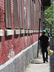 What's in the bag? (Alex L'aventurier,) Tags: city windows light shadow red people wall walking rouge montral lumire montreal pedestrian ombre mur ville fentres piton