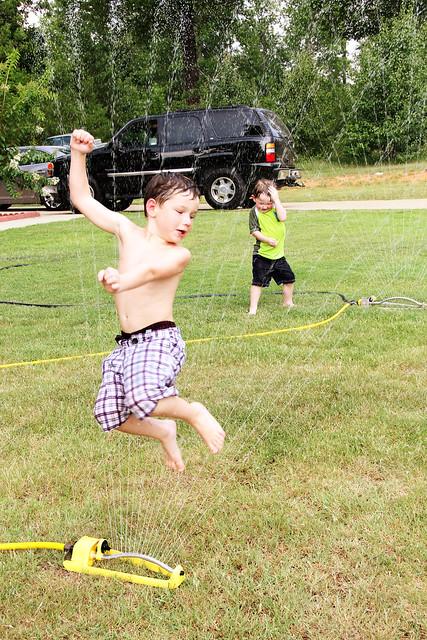 running through the sprinklers