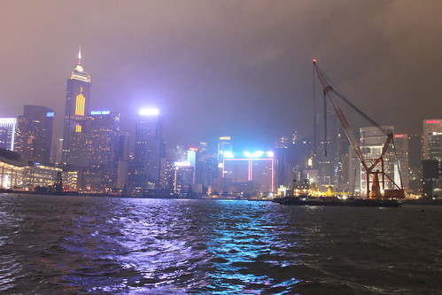 Hong Kong skyline night view from a ferry on Victoria Harbor. by emaggie
