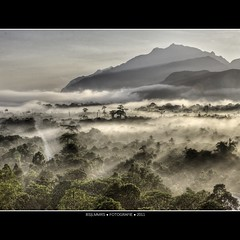 Malaysia: Mulu cave mountains (Bas Lammers) Tags: road sun mist mountains tree fog forest sunrise canon airport miri jungle malaysia layers cave mulu 50d