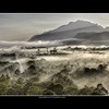 Malaysia: Mulu cave mountains (Bas Lammers) Tags: road sun mist mountains tree fog forest sunrise canon airport miri jungle malaysia layers cave mulu 50d