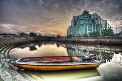 MAll HDR (HardBreakKid) Tags: sunset bw reflection building water clouds canon mall river concrete boat skies yamaha brunei 1022mm hdr watertaxi cpl manfrotto gadong hoya photomatix nd8 eos50d phottix menglaitriver