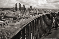 The City from St. Paul's (TIA International Photography) Tags: city uk england building london june st skyline skyscraper fence tia spring cityscape cathedral britain district united capital great pillar central kingdom business wharf dome column canary railing rotunda financial tosin pauls arasi visipix tiascapes tiainternationalphotography