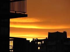 Marmalade Sky (Marcia Portess) Tags: sunset sky orange yellow clouds buildings skies colours silhouettes balconies orangesky balcones puestadelsol marmaladesky kartpostal flickrduel westendvancouvercanada marciaportess