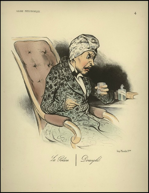 seated, obviously angrily distressed, old woman with head scarf holds glass
