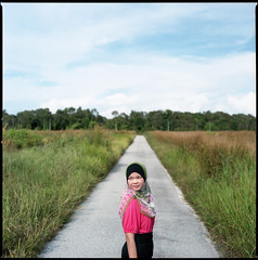 121649 (Nasey) Tags: road pink portrait people 120 6x6 film grass mediumformat alley amy hijab squareformat malaysia terengganu tudung carlzeiss 80mmf28 hasselblad503cw setiu lembahbidong nasey nasirali ikha planarcft