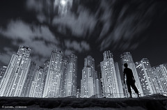 Dark City (DanielKHC) Tags: city portrait bw white black beach monochrome silhouette night clouds self buildings dark nikon long exposure dubai uae residence cinematic jumeirah d300 jbr danielcheong danielkhc tokina1116mmf28