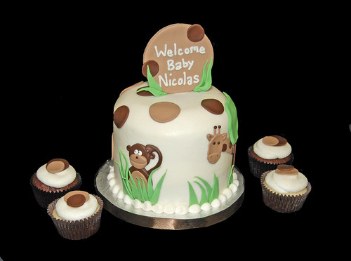 cream and brown jungle themed baby shower cupcake tower with monkey and giraffe