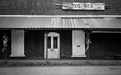 The Lost America (evanleavitt) Tags: world county old windows our film rotting sign analog rural america self 35mm ga way georgia lost store nikon missing doors darkness cola kodak south trix bricks country away used southern american 400 be nostalgic weathered to morgan fm10 rodinal nostalga coca developed boarded shut slower the bostwick