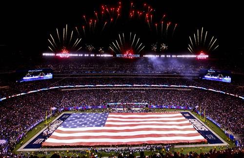Marines, Sailors, Coast Guardsmen, Airmen and Soldiers unfurl American