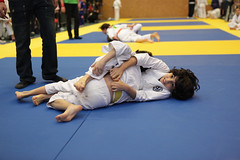 Children grappling (BBJJA) Tags: boy two people judo rivalry sport kids children fight fighter child play power jujitsu martial attack arts competition indoor martialarts tournament entertainment winner catch strong strength practice win jiujitsu combat youngadult success adolescent twopeople hold wrestle struggle looser brasilian sparring competitive competitor discipline grappling offence