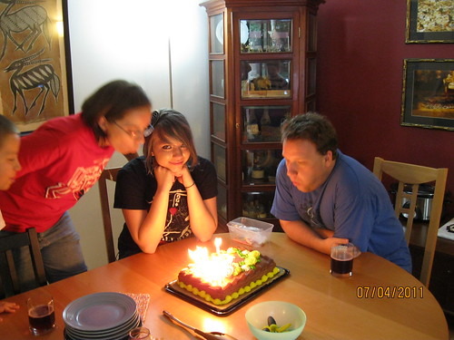 7/4/11: Why is Katherine in the center seat for our cake??