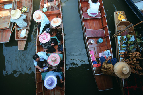 Floating market, Vietnam. Photo by Dominyk Lever, 2004