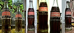 Even if you can't read the Bangla script, I'm sure you know what this is! (BigMs.Take) Tags: signs collage bottle nikon panel coke noflash nightshots cocacola symbols logos bangladesh corporateamerica d300 multipleimages multinationalcompany globalicon bengaliscript