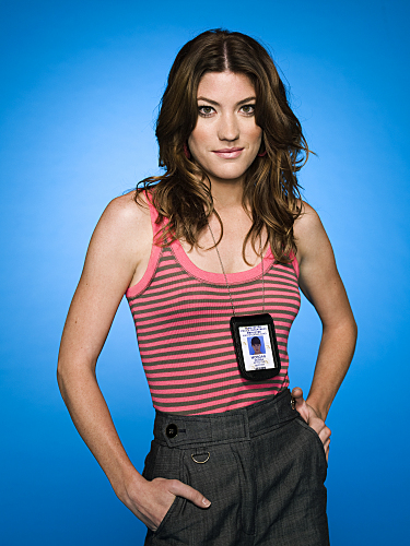 Dexter's Deb, a white woman with brown hair, posing for the camera wearing casual clothes