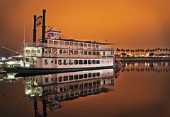 Grand Romance Riverboat (skipmoore) Tags: reflection night harbor longbeach riverboat grandromanceriverboat