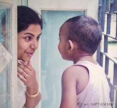 Conversation... (Saptashaw Chakraborty) Tags: india canon kid child play mother sigma nephew innocence kolkata 50d eos50d 1770oshsmmacro