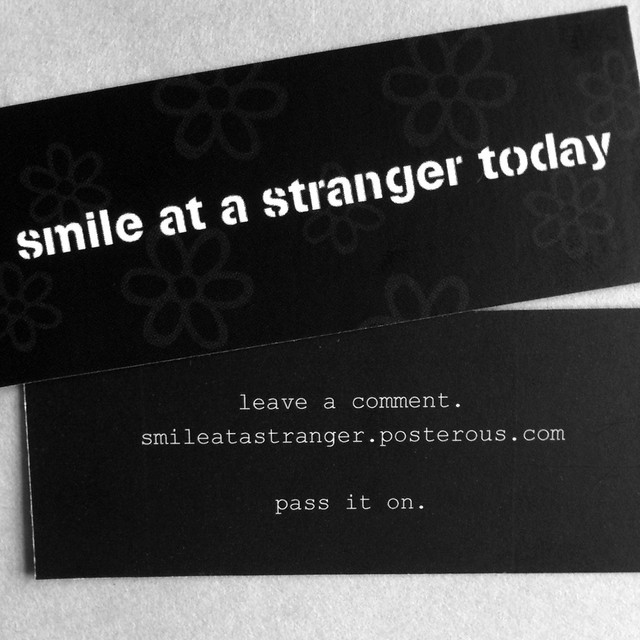 smile at a stranger today