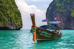 Maya Bay - A Thailand Clich (Jim Boud) Tags: ocean travel vacation seascape water clouds movie landscape thailand islands boat colorful asia southeastasia paradise tour turquoise relaxing vivid wideangle flags thai tropical tropicalisland colourful lush woodenboat phuket efs hdr highdynamicrange tutorial cliche dinghy thebeach lightroom leonardodicaprio artisticphotography superwideangle clich asiapacific phiphiislands mayabay phuketisland phiphiley jimboud thebeachmovie canoneos60d hybridhdr jamesboud canonefs1585mmf3556isusm canon1585mm lpbays