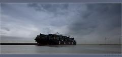 hij is groot... (Rogier Coppejans) Tags: sea cloud water clouds zeilen photoshop boot boat wolken windmills zee ps windmolen oceaan groot varen dreigend coppejans cs5