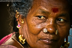 portrait of a beautiful old lady at the market madurai- -tamil nadu- -south india (anthony pappone photography) Tags: portrait people india lady digital canon pose photo faces image expression retrato picture culture earrings ritratto madurai tamil tamilnadu southindia photograher phototravel    eos400d