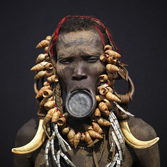 Mursi woman with lip plate - Ethiopia (Eric Lafforgue) Tags: woman artistic culture tribal ornament clay valley tribes bodypainting tradition tribe ethnic rite bodymodification tribo labret adornment pigments ethnology tribu omo eastafrica thiopien etiopia ethiopie etiopa 3264  etiopija ethnie ethiopi  lipplug etiopien etipia  etiyopya  nomadicpeople         peoplesoftheomovalley lipdisclipplate piercedhole piercedlipornament
