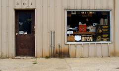 Jim's Service Station, Lismore, Minnesota (Funkomaticphototron) Tags: door brown window minnesota sign beige rust open sad shocks think gas gasstation dont crate mn lismore 301 coryq i so coryfunk jimsservicestation