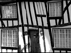 The Crooked House (flosspot) Tags: door old windows blackandwhite bw house window lines cottage line beam repetition beams crooked beginnerdigitalphotographychallengewinner canong10 lynettecoates