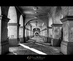 Balboa Park Hallway (Chad McDonald) Tags: california ca light usa white black digital canon hall arch shadows sandiego chad path walk side pillar columns hallway sidewalk walkway prado mcdonald balboapark