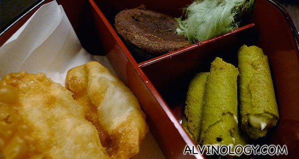 Close-up of the items in the left bento box