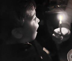 blowing out the birthday candle (Mudcat2010) Tags: birthday boy white black canon candle blow flame surprise wish dpsbwportrait