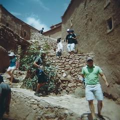 Ait Benhaddou tourists (sonofwalrus) Tags: africa city film architecture buildings holga lomo lomography mud scan morocco aitbenhaddou   hpc5380