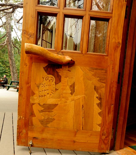 Owl forest, fitted polished wood door, with natural handle, glass panels, lodge deck, Breitenbush Hot Springs, Breitenbush, Marion County, Oregon, USA by Wonderlane