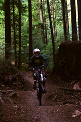 A. Beaton (Leon Kozlov) Tags: mountain vancouver forest canon north downhill trail shore biking 7d bobsled fromme norco wheelie