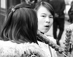 Sweets (ROSS HONG KONG) Tags: china leica portrait bw white black apple girl 35mm candy chinese beijing sweets stick f2 wanfujingstreet m9p