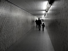 A father is always making his baby into a little woman.  And when she is a woman he turns her back again.  ~Enid Bagnold ( fotodisignorina  Felicia Violi PHOTOGRAPHY) Tags: bw baby digital canon dad father daughter tunnel trainstation canonpowershot canonphotography