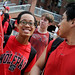 Students  wearing red received free goodies during the first Wear Red Friday on the Brickyard.