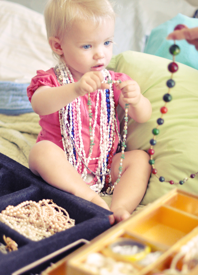 delilah trying on nana's vintage  necklaces
