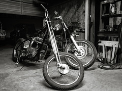 Choppers (avilon_music) Tags: california nightphotography bw shop night vintage la blackwhite losangeles chopper garage motorcycles olympus harleydavidson triumph motorcycle hd springer southerncalifornia choppers arlenness kustom t120 kustomkulture markpeacockphotography avilonmusic 72t120r