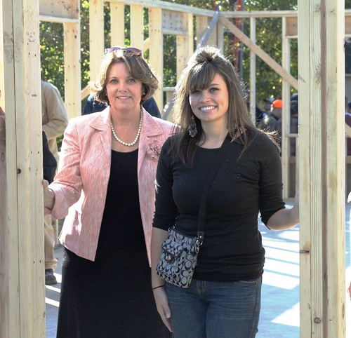 State Director Colleen Landkamer helped Jessi Mattila raise the final wall on her new home in Mountain Iron, Minn. recently. The home is financed through USDA and built with support from the Habitat for Humanity.