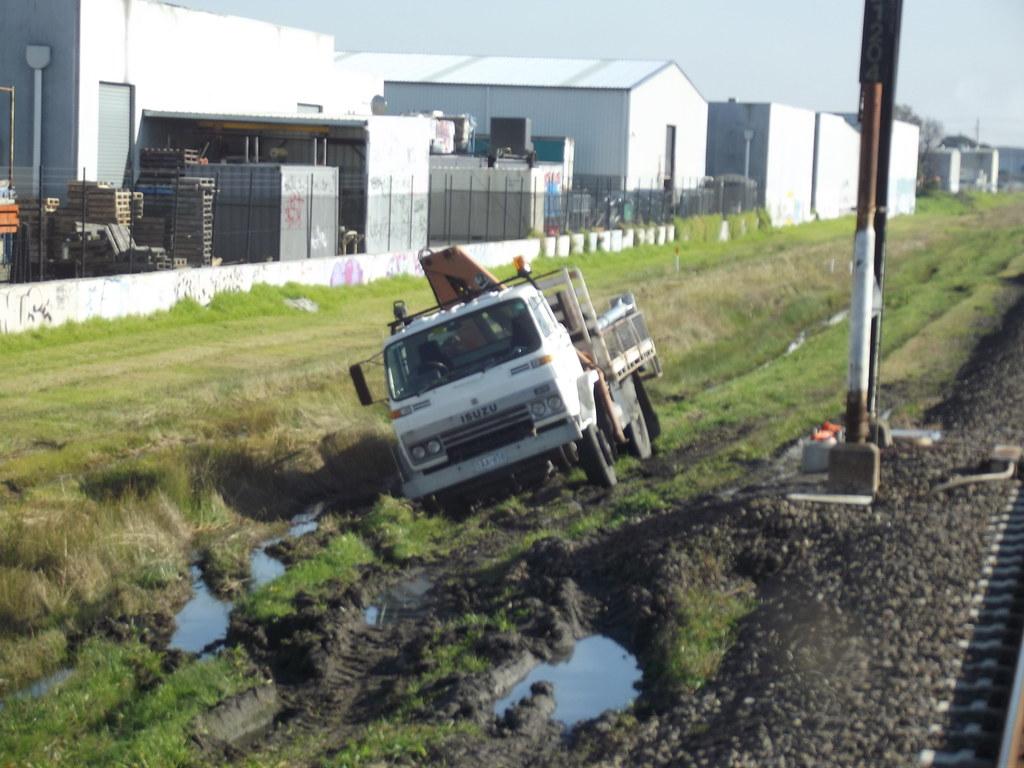 Bogged Metro Isuzu work truck 2011