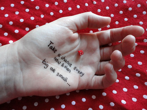 Take a chance polkadot hand dice 1