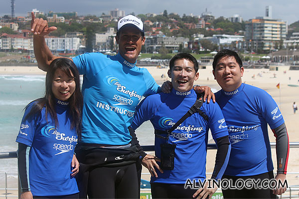 The three of us with our cool surfing coach (all surfing images provided by Let's Go Surfing)