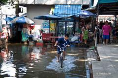 Bangkok Flood Prevention October 2011 (Photasia) Tags: water bike bicycle thailand kid child flood bangkok capital streetlife th floods sandbags sandbag floodprevention krungthep floodalert photasia