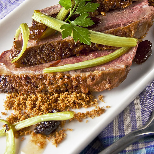 Pan-fried Duck breast over spiced toasted breadcrumbs and served with sweet-sour celery and raisins